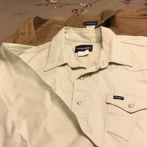 Two men's snap up shirts